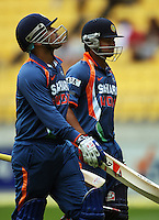 India's Virender Sehwag and his runner Raina Suresh walk back to the stand after Sehwag was dismissed for 54 during the 2nd ODI cricket match between the New Zealand Black Caps and India at Westpac Stadium, Wellington, New Zealand on Friday, 6 March 2009. Photo: Dave Lintott / lintottphoto.co.nz