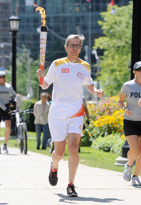 Toronto, ON - Aug 7 2015 - Canadian Paralympic Committee President Gaetan Tardiff participates in the torch relay for the Toronto 2015 Parapan American Games  (Photo: Matthew Murnaghan/Canadian Paralympic Committee)