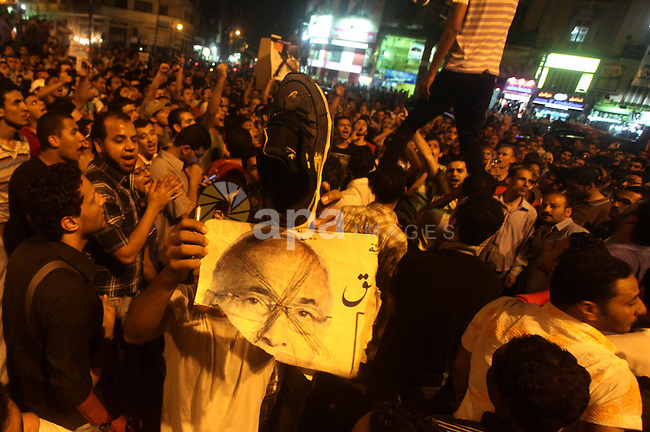 A youth takes part in a demonstration in Tahrir Square to protest the outcome of the Egyptian presidential election, Cairo, Egypt, Monday May 28, 2012. The runoff vote for Egypt's next president will pit the Muslim Brotherhood's candidate against the last prime minister to serve under Hosni Mubarak, according to full official results released Monday by the election commission. Commission chief Farouq Sultan told a news conference that the Brotherhood's Mohammed Morsi and Ahmed Shafiq, a former air force commander and a longtime friend of the ousted leader, were the top two finishers in the first round of voting held on May 23-24. Photo by Ashraf Amra