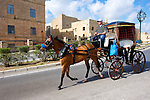 Valetta in Malta.  In Valetta, Malta the horse-drawn carriage or karrozini is a popular way to get around town or take a guided tour.  Valletta, Malta's capital, is a UNESCO World Heritage Site, a city of Baroque architecture left by the Knights of St. John five centuries ago.