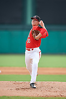 Canadian Junior National Team pitcher Theo Millas (30) delivers a pitch during a Florida Instructional League game against the Atlanta Braves on October 9, 2018 at the ESPN Wide World of Sports Complex in Orlando, Florida.  (Mike Janes/Four Seam Images)