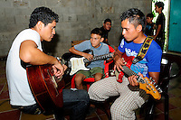 Pedro Esquival Chavez, music teacher from the Music for Hope youth project, leading a music workshop in the community of Zamoran, El Salvador.