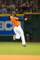 Houston Astros second baseman Jose Altuve (27) makes a leaping over the head catch during the MLB baseball game against the Detroit Tigers on May 3, 2013 at Minute Maid Park in Houston, Texas. Detroit defeated Houston 4-3. (Andrew Woolley/Four Seam Images).