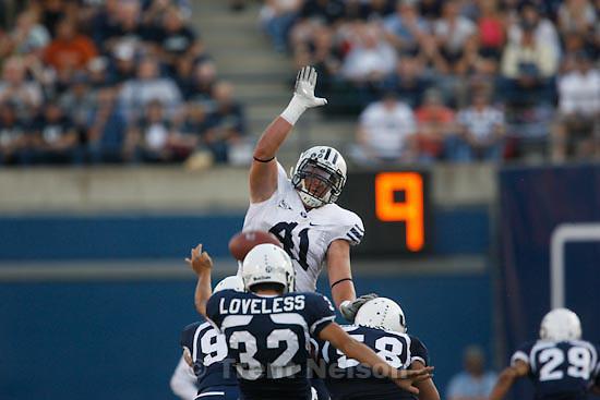 Trent Nelson  |  The Salt Lake Tribune.BYU defensive lineman Matt Putnam (41) tries to block a punt by Utah State's Braeden Loveless. Utah State vs. BYU college football in Logan Friday, October 1, 2010.