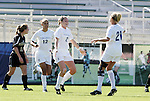 Virginia's Jen Redmond (2) celebrates her goal at 14:39 with teammates Jess Rostedt (12) and Kelly Hammond (21) on Wednesday, November 2nd, 2005 at SAS Stadium in Cary, North Carolina. The University of Virginia Cavaliers defeated the Wake Forest Demon Deacons 2-1 during their Atlantic Coast Conference Tournament Quarterfinal game.