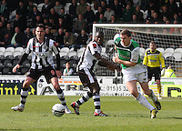 Paul hanlon (right) beats Nigel Hasselbank in the St Mirren v Hibernian Clydesdale Bank Scottish Premier League match played at St Mirren Park, Paisley on 29.4.12.