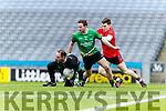Kieran Courtney Glenbeigh Glencar in action against Seamus Donaghy, Mark McAleer Rock Saint Patricks in the Junior Football All Ireland Final in Croke Park on Sunday.