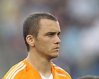 Houston Dynamo forward Cam Weaver (15). In a Major League Soccer (MLS) match, Houston Dynamo (orange) defeated the New England Revolution (blue), 2-1, at Gillette Stadium on July 13, 2013.
