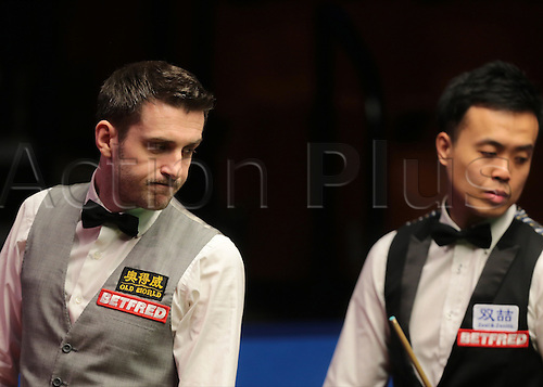 30.04.2016. The Crucible, Sheffield, England. World Snooker Championship. Semi Final, Mark Selby versus Marco Fu. Mark Selby looks on at his snooker, as Marco Fu prepares to take a shot