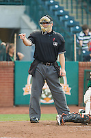 Home plate umpire Tucker Benville makes a strike call during the South Atlantic League game between the Hagerstown Suns and the Greensboro Grasshoppers at NewBridge Bank Park on May 20, 2014 in Greensboro, North Carolina.  The Grasshoppers defeated the Suns 5-4. (Brian Westerholt/Four Seam Images)