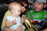 Sept. 30, 2012; Madison, IL, USA: NHRA funny car driver Jack Beckman celebrates with wife Jenna and daughter Layla after winning the Midwest Nationals at Gateway Motorsports Park. Mandatory Credit: Mark J. Rebilas-