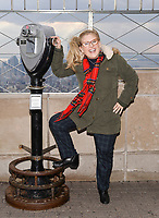 """New York - DECEMBER 17: Nancy Cartwright participates in the ceremonial lighting of the Empire State Building as they attend the Empire State Building Celebration of the 30th Anniversary of FOX's """"The Simpsons"""" on December 17, 2018 in New York City.  (Photo by Anthony Behar/FOX/PictureGroup)"""