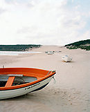 SPAIN, Andalusia, Tarifa, boats on sand at beach