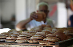 A picture taken on May 16, 2018 shows a Palestinian vendor sells breads at a market during the holy month of Ramadan, in the West Bank city of Nablus. Ramadan is sacred to Muslims because it is during that month that tradition says the Koran was revealed to the Prophet Mohammed. The fast is one of the five main religious obligations under Islam. Muslims around the world will mark the month, during which believers abstain from eating, drinking, smoking and having sex from dawn until sunset. Photo by Ayman Ameen