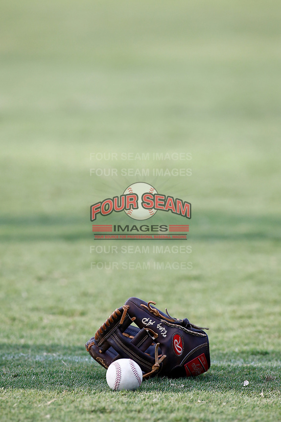 A ball and glove sits on the outfield playing surface during warmups on July 27, 2018 at AT&T Field in Chattanooga, Tennessee. (Andy Mitchell/Four Seam Images)