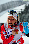 HOLMENKOLLEN, OSLO, NORWAY - March 17: Therese Johaug of Norway (NOR) shows her Holmenkollen medal (Norwegian skiing's highest award for competitors) at the FIS Cross Country World Cup on March 17, 2013 in Oslo, Norway. (Photo by Dirk Markgraf)..