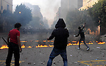 Egyptian protesters throw stones to the army during clashes in Kasr al-Aini, Cairo, Egypt, 17 December 2011. According to media reports, the clashes, the worst in three weeks, erupted on 16 December after protesters accused the army forces of attacking one of them. More than 300 people were injured in the violence, according to government figures. Army forces 17 December set up a non-go zone near Tharir Square where the fighting raged for several hours on 16 December, reported state television. A major fire on 17 December gutted a library located near the parliament building. A small fire, meanwhile, erupted inside the nearby cabinet headquarters. The protesters had camped since late November outside the cabinet offices to prevent Egyptian Prime Minister al-Ganzouri from entering. They regard him as part of the Mubarak regime under which he served as prime minister in the 1990s. Photo by Ahmed Asad