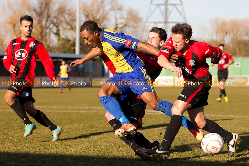 Tyrone Scarlett of Romford tries to burst through the Chatham defence - Romford vs Chatham Town - Ryman League Division One North Football at the Thurrock FC, Ship Lane - 07/03/15 - MANDATORY CREDIT: Ray Lawrence/TGSPHOTO - Self billing applies where appropriate - contact@tgsphoto.co.uk - NO UNPAID USE