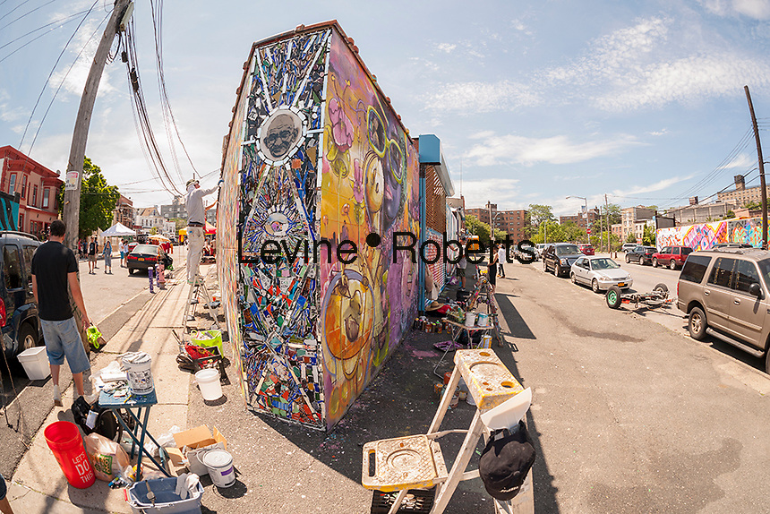A mosaic at the corner of a building by J. Carlos Pinto at the Welling Court Mural Project in the Astoria neighborhood of Queens in New York on Saturday, June 13, 2015. The annual neighborhood event decorates walls in this industrial part of Astoria. The project is crowd-funded and emerging street artists work side by side with established stars.  (© Richard B. Levine)