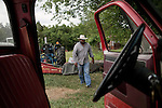 May 22, 2010. Baskerville, Virginia.. John Boyd, Jr. finishes working on a tractor on land that he and his father lease over 20 miles from their family farm to run cattle on, as they are unable to find land closer to home.. Dr. John Boyd, Jr., a Virginia farmer, has lobbied the White House and Congress for the better part of two decades on behalf of black farmers. .A $1.25 billion settlement he helped to negotiate in February for the federal government to compensate black farmers has become ensnared in Washington. .Meanwhile, many elderly farmers who stand to benefit are dying before they can seek restitution..Their case, known as the black farmers settlement, and commonly referred to as Pigford II, is the second phase of a federal lawsuit settled in 1999. It covers more than 80,000 farmers who claim they were denied critical aid comparable to what white farmers received from the Department of Agriculture between 1981 and 1996 because of the color of their skin..Congress reopened the case in 2008, and set aside $100 million to address the late claims. President Barack Obama, who co-sponsored the 2008 measure when he was in the Senate, created a $1.15 billion line item in his budget for the 2010 fiscal year to cover the new class of litigants..The money was less than half of the $2.5 billion the farmers had fought for, but the administration's promise of a quick resolution prompted them to accept the deal.  .