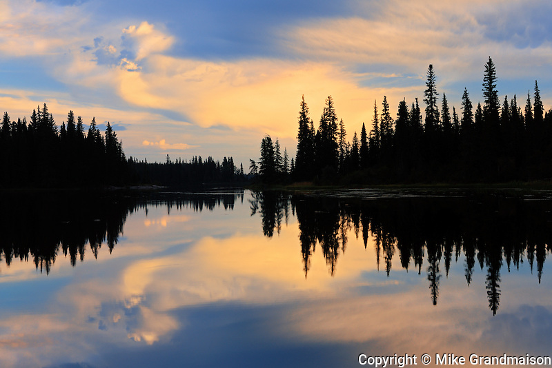 Boreal forest reflected in Grass River<br /> Pisew Falls Provincial Park<br /> Manitoba<br /> Canada