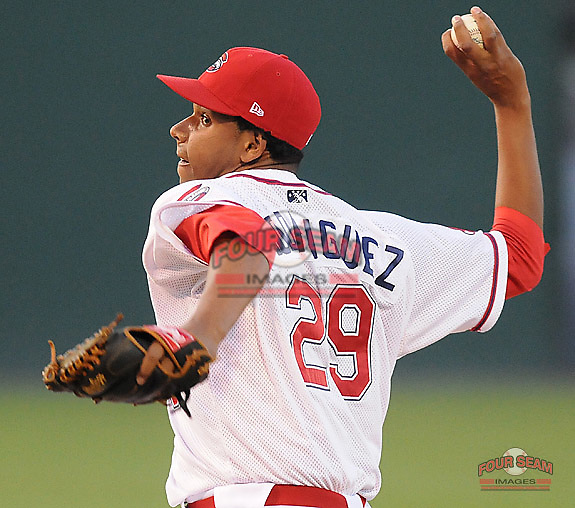 Juan Rodriguez (29) of the Greenville Drive, Class A affiliate of the Boston Red Sox, in a game against the Lakewood BlueClaws on July 12, 2011, at Fluor Field at the West End in Greenville, South Carolina. (Tom Priddy/Four Seam Images)