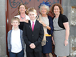 Eoin McDaid from Callystown NS who received confirmation at St Michael's church Clogherhead pictured with mam Carainn,  grandmother Ann McBride and Henry and Niamh Simms. Photo: Colin Bell/pressphotos.ie
