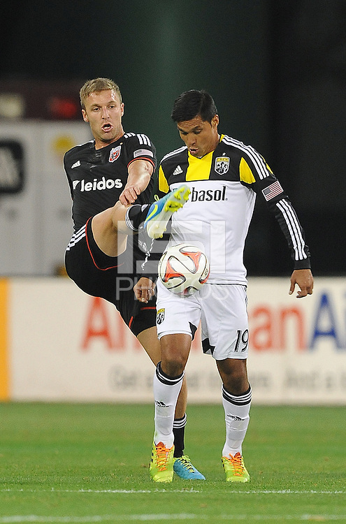 Washington D.C. - March 8, 2014: Jairo Arrieta (19) of the Columbus Crew goes against Jeff Parke (2) of D.C. United.   The Columbus Crew defeated D.C. United 3-0 during the opening game of the 2014 season at RFK Stadium.