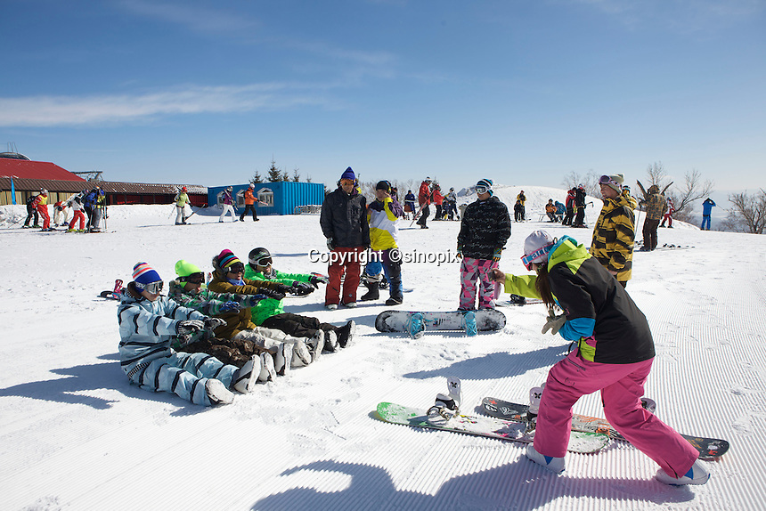 """A group of skiing enthusiast from Liaoning province, ski in the Club Med Sun Mountain Yabuli Resort. The first Club Med's holiday resort in China, which is jointly managed by Melco China Resorts (Holding) Limited & Club Med Asie S.A. (""""Club Med"""")."""