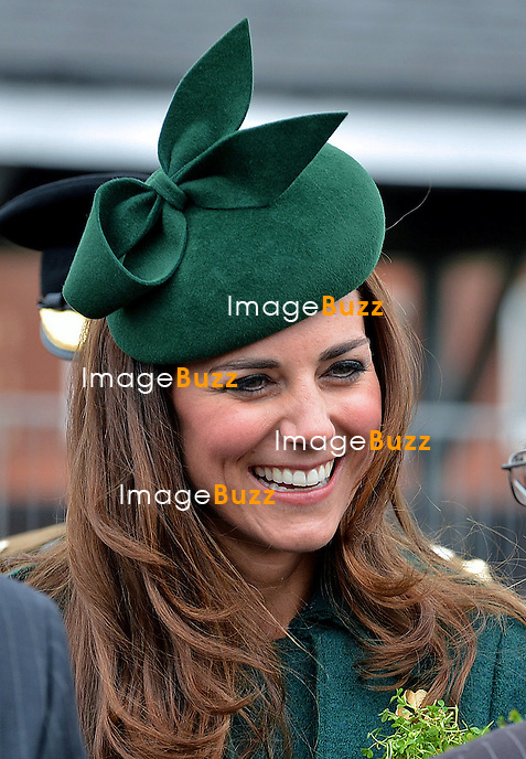 PRINCE WILLIAM AND CATHERINE,  DUCHESS OF CAMBRIDGEvisited the 1st Battalion Irish Guards on St. Patrick's Day Parade at Mons Barracks, Aldershot. <br /> The Duchess of Cambridge presented the traditional sprigs of shamrocks to the Officers and Guardsmen of the Regiment and to Domhnall their Irish Wolf Hound regimental mascot.<br /> The Duke of Cambridge is Colonel of the Regiment_17/03/2014