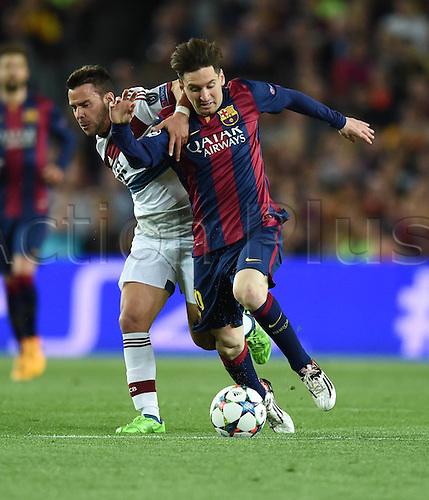 06.05.2015. Nou Camp, Barcelona, Spain, UEFA Champions League semi-final. Barcelona versus Bayern Munich.  Juan Bernat (Bayern Munich) grapples with Lionel Messi (Barca)