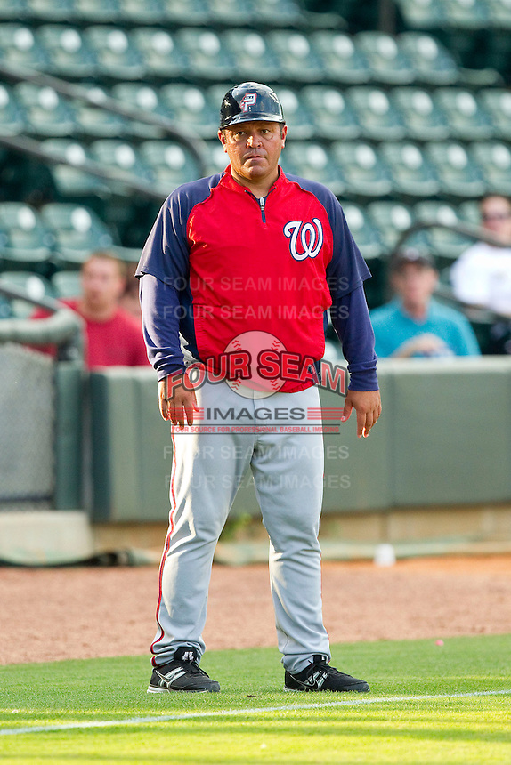Potomac Nationals manager Brian Daubach (23) coaches third base during the Carolina League game against the Winston-Salem Dash at BB&T Ballpark on July 8, 2013 in Winston-Salem, North Carolina.  The Dash defeated the Nationals 12-9.  (Brian Westerholt/Four Seam Images)