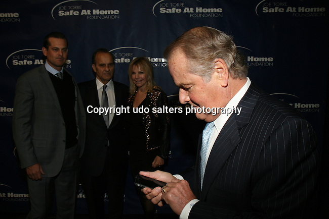 Former New York Rangers Hockey Player Rod Gilbert Trying to Figure Out Why His Camera Phone Is Not Working at 11TH ANNIVERSARY OF THE JOE TORRE SAFE AT HOME FOUNDATION HELD A CHELSEA PIERS SIXTY, NY