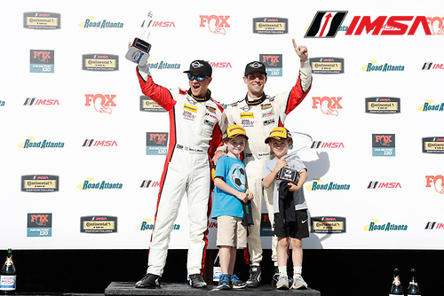 #73 MINI JCW Team, MINI JCW, ST: Mat Pombo, Mike LaMarra celebrate on the podium