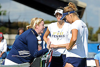 18 March 2012:  FIU Tennis Head Coach Melissa Applebaum-Dallau speaks with Sarah McLean and Rita Maisak during a break in the doubles match as the Columbia Lions defeated the FIU Golden Panthers, 5-2, at University Park in Miami, Florida.