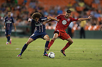 Adrien Rabiot (31) of Paris Saint-Germain FC fights for the ball with Perry Kitchen (23) of D.C. United during the game at RFK Stadium in Washington, DC.  Paris Saint-Germain FC tied D.C. United, 1-1.