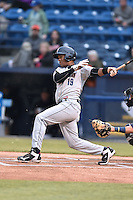 Asheville Tourists designated hitter Abiatal Avelino (19) swings at a pitch during a game against the Charleston RiverDogs on April 30, 2015 in Asheville, North Carolina. The RiverDogs defeated the Tourists 5-4. (Tony Farlow/Four Seam Images)