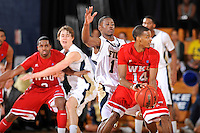 28 January 2012:  FIU guard Deric Hill (1) defends WKU guard Jamal Crook (14) in the second half as the Western Kentucky University Hilltoppers defeated the FIU Golden Panthers, 61-51, at the U.S. Century Bank Arena in Miami, Florida.