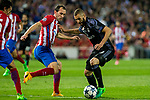 Karim Benzema of Real Madrid holds off pressure from  Diego Godin of Atletico de Madrid during the match of Champions League between Atletico de Madrid and Real Madrid at Vicente Calderon Stadium in Madrid, May 10, 2017. Spain.