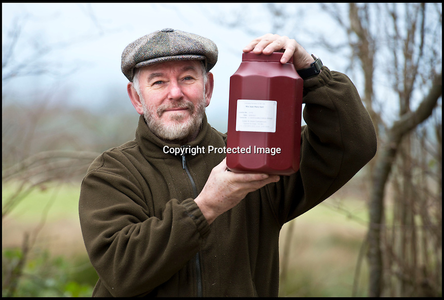 BNPS.co.uk (01202 558833)<br /> Pic: RachelAdams/BNPS<br /> <br /> Matt with the urn containing his mum's ashes. <br /> <br /> A grieving son who had his pick-up truck stolen with the ashes of his dead mother inside is delighted after finding them returned to his parking space.<br /> <br /> Matt Hart, 62, had picked up the remains of mum Joan from the funeral directors and was planning to take them to a memorial service for her.<br /> <br /> He left them in his Toyota vehicle which was broken into and taken in the middle of the night on 16 January.<br /> <br /> The white truck was found abandoned in a country lane missing its while and all personal possessions inside, including the urn.<br /> <br /> Mr Hart scoured hedgerows surrounding the vehicle in Bridport, Dorset, but there was no sign of the ashes.<br /> <br /> But more than two weeks later they were mysteriously found in the very parking space the vehicle was stolen from.<br /> <br /> It is thought the thieves might have returned to the garage complex and replaced the urn after Mr Hart took to Facebook to launch an appeal.<br /> <br /> He is now looking after them at home until one of his family come to visit and take them near to Applecross in Wester Ross, Scotland, where they will be scattered.