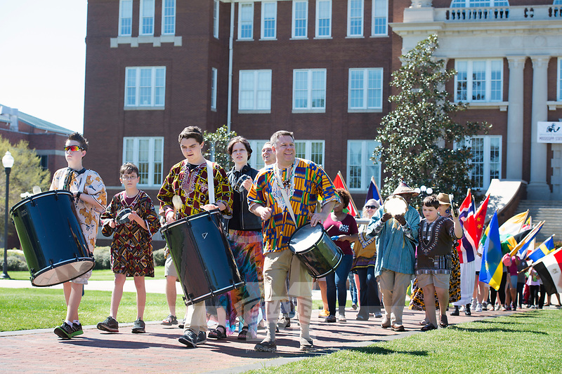 International Fiesta 2017 - Drill Field festival - parade of flags, led by drummers.<br />