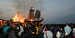 Donggang, Taiwan -- Spectators watching the King Boat on its last voyage at the beach.