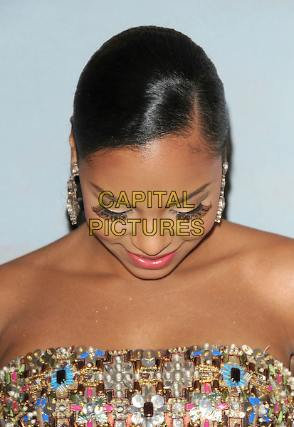 ASHANTI aka Ashanti Shequoiya Douglas.at The Jenesse Silver Rose Gala & Auction held at The Beverly Hills Hotel in Beverly Hills, California, USA, .April 19th 2009                                                                     .portrait headshot gold strapless shiny beaded embellished blue pink looking down eyelashes funny .CAP/DVS.©RockinExposures/Capital Pictures