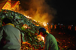 Donggang, Taiwan -- The King Boat is set ablaze with firecrackers.