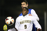 25 October 2013: Wake Forest's Sean Okoli (9) and Duke's Will Donovan (behind). The Duke University Blue Devils hosted the Wake Forest University Demon Deacons at Koskinen Stadium in Durham, NC in a 2013 NCAA Division I Men's Soccer match. The game ended in a 2-2 tie after two overtimes.