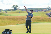 Charley Hoffman (USA) throws his ball into the stands after sinking his long par saving putt on 18 during Sunday's round 4 of the 117th U.S. Open, at Erin Hills, Erin, Wisconsin. 6/18/2017.<br /> Picture: Golffile | Ken Murray<br /> <br /> <br /> All photo usage must carry mandatory copyright credit (&copy; Golffile | Ken Murray)