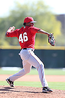 Eswarlin Jimenez #46 of the Los Angeles Angels pitches during a Minor League Spring Training Game against the Oakland Athletics at the Los Angeles Angels Spring Training Complex on March 17, 2014 in Tempe, Arizona. (Larry Goren/Four Seam Images)