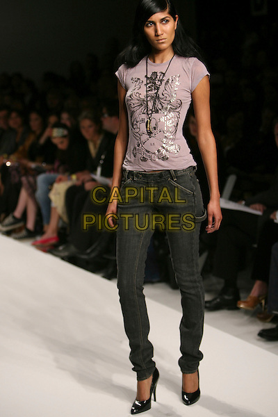 MODEL.Mercedes-Benz Fall 2006 L.A. Fashion Week at Smashbox Studios, Culver City, California, USA - Morphine Generation - Runway.March 20th, 2006.Photo: Zach Lipp/AdMedia/Capital Pictures.Ref: ZL/ ADM.catwalk full length jeans denim t shirt.www.capitalpictures.com.sales@capitalpictures.com.© Capital Pictures.