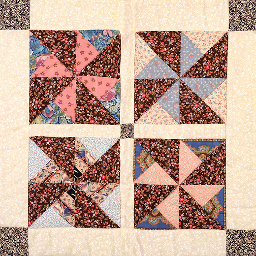 This is a quilt block from a large full size quilt of 25 squares that was hand stitched by my mother in the eighties. With this pinwheel design, she used up a lot of little scraps and each of the 25 blocks are in different colors in this same pattern. I hung the antique quilt over a high rod in the studio and shifted it around to get a close-in image of all 25 squares. My mother was an artist herself and she had a very good sense of what would work well together, as seen throughout this quilt block series. They are offered as a 15x15 canvas which is just shy of actual size, and they are a nice slice of traditional Americana.