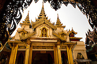 The Shwedagon Pagoda; Mon officially named Shwedagon Zedi Daw and also known as the Great Dagon Pagoda and the Golden Pagoda, is a gilded stupa located in Yangon, Myanmar.